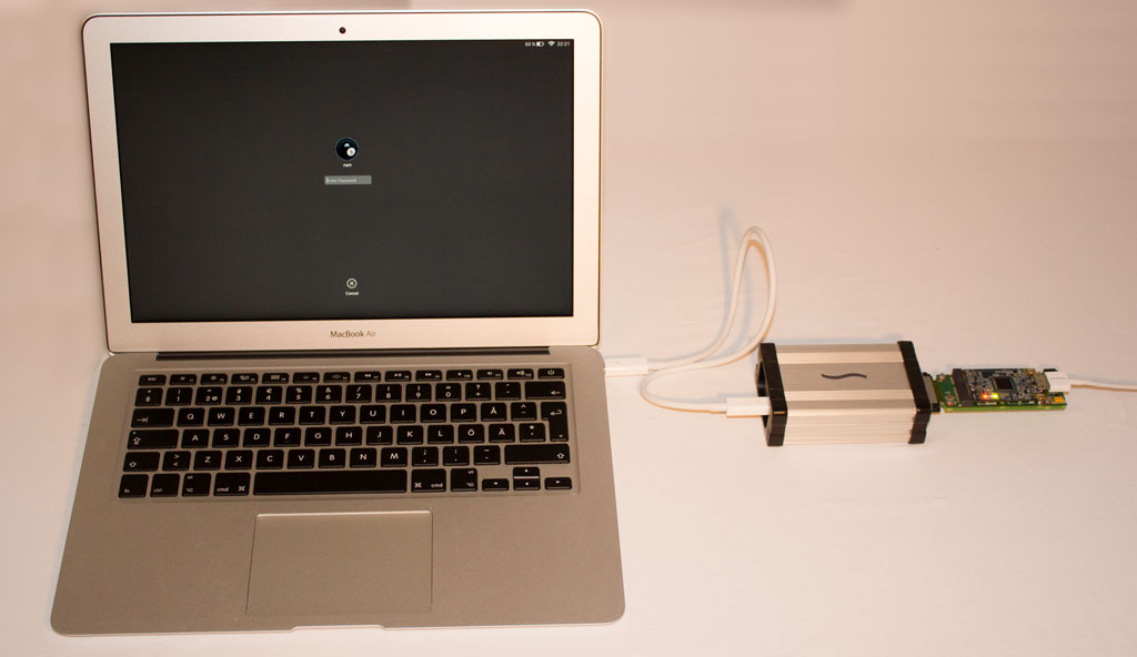 PCILeech device connected to a MacBook Air