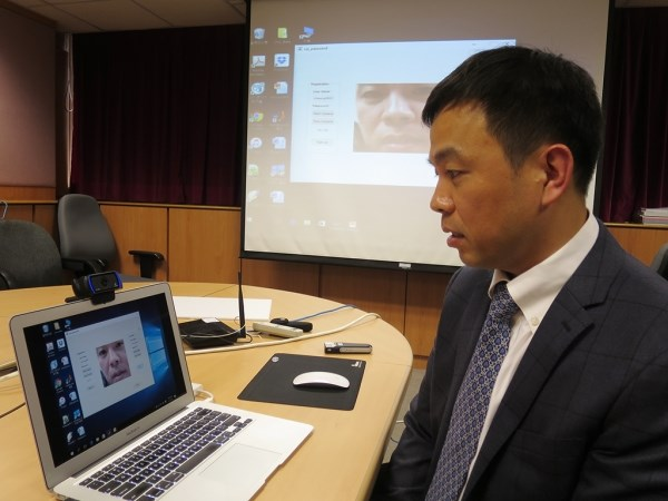 HKBU's Department of Computer Science Professor Cheung Yiu-ming demoing the lip password technology