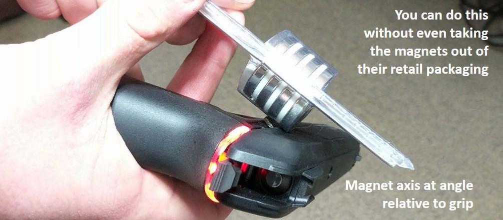 Magnets held near an Armatix IP1 smart pistol