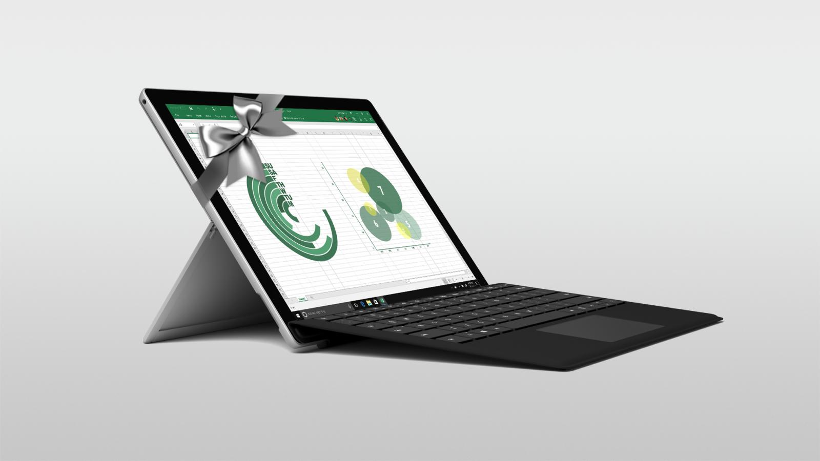 The new Surface Pro wrapped in a silver bow with Excel shown on the screen.